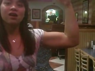 Nice Biceps Girl flex in a restaurant
