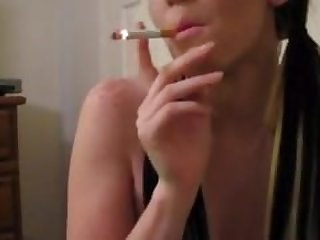 Sexy Cam Girl Smokes Poses