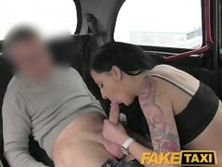 FakeTaxi Black haired tattooed young..